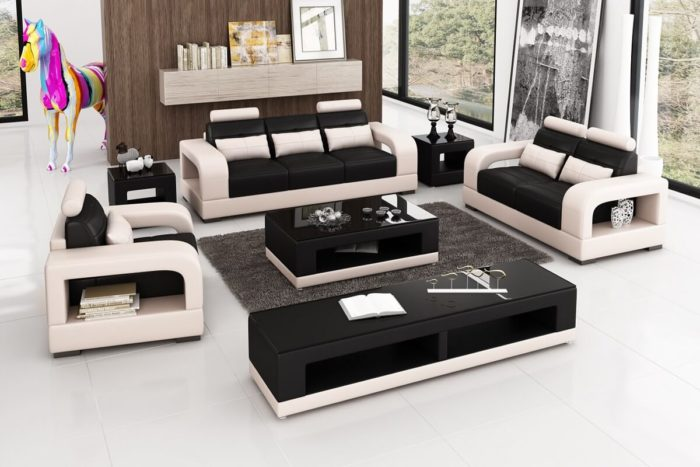 black leather couch set with table