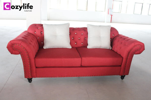 red tufted loveseat sofa