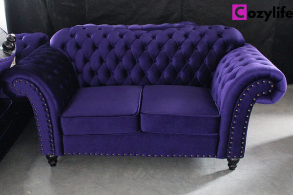 purple tufted loveseat sofa