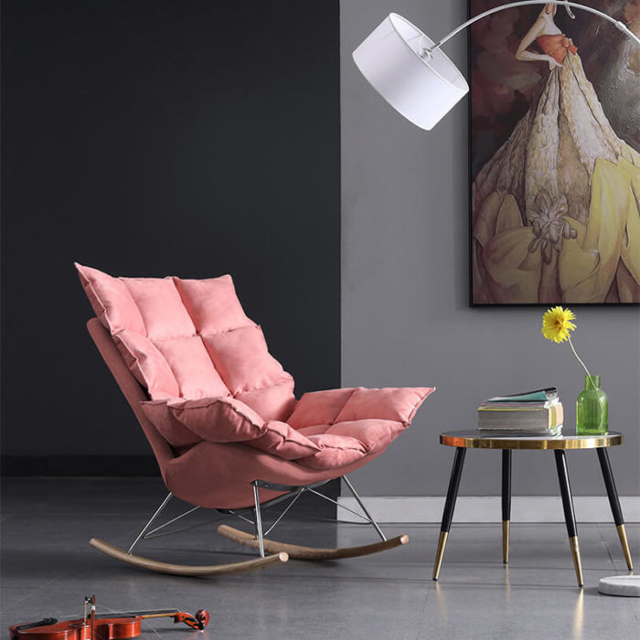 pink armchair with footrest