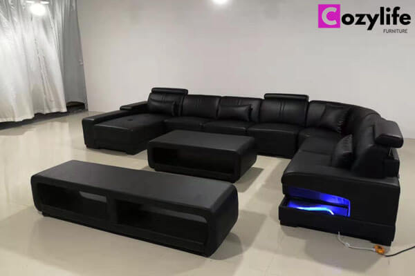 large black sectional sofa with tables