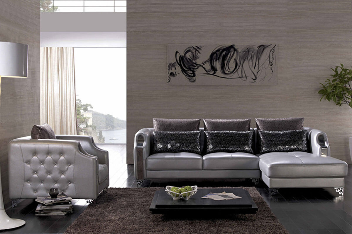 button-tufted leather sofa with chaise
