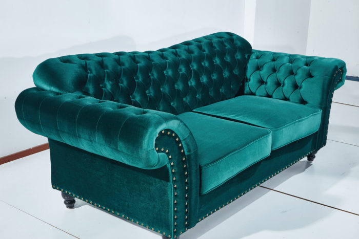green fabric loveseat chesterfield