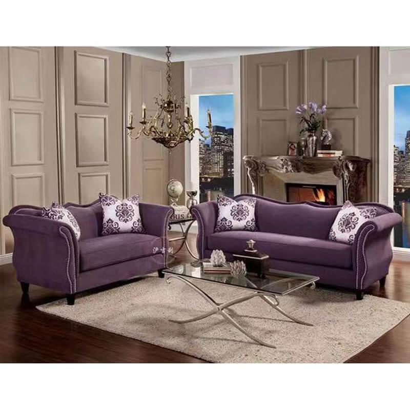 purple curved camel back fabric sofa