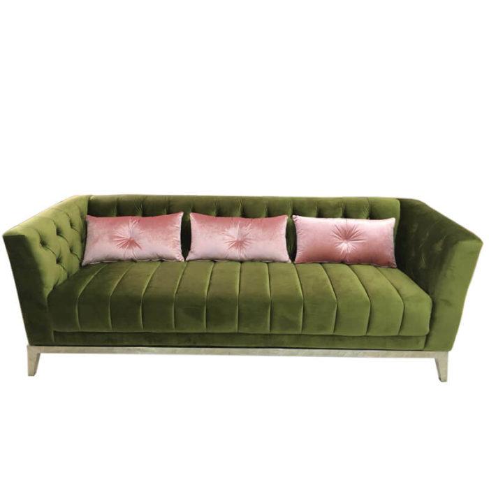 Emerald green velvet tufted sofa