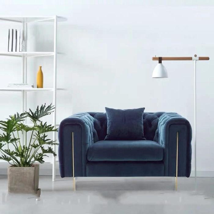 single blue chesterfield chair